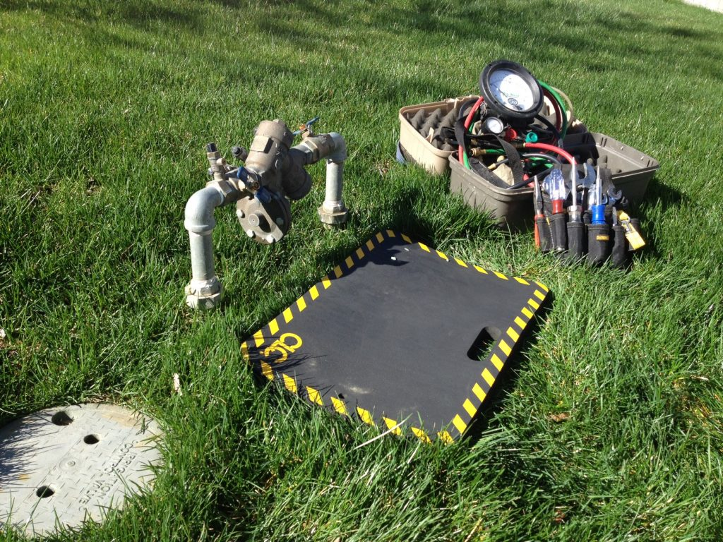 backflow testing equipments in a backyard